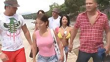 Beach goers fucking around for the camera