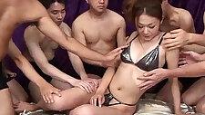 Sakura Hirota enjoys being the centerpiece in this raunchy orgy