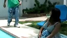 Pregnant ebony is having fun getting down by the pool hi